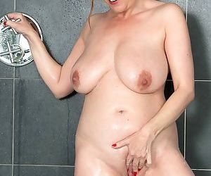 Chubby middle aged lady gets dressed after taking a stimulating shower