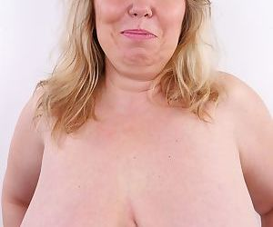 Obese blond lady takes off her clothes to model in the buff for the first time