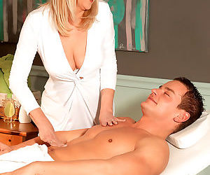 Mature massage therapist obliges her client and sucks his cock