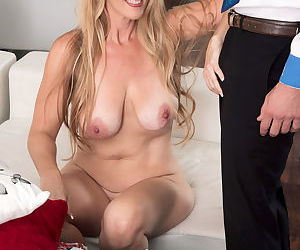 Blonde mature vixen in glasses Sasha Bell enjoys being stuffed with a pecker