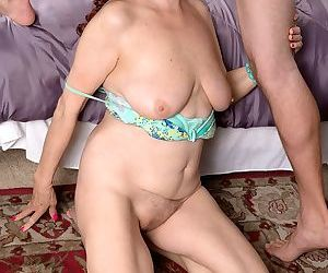 Redheaded granny Katherine Merlot sports a creampie after sex with her toy boy
