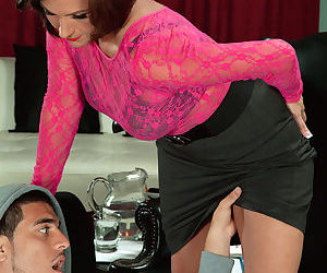Hot grandmother Yasmine Beale seduces a younger dude in a black skirt