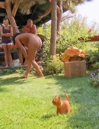 2 young Euro girls play foursome sex games in the backyard