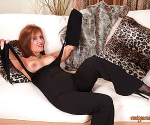 Rich pornstar Roni posing in high heels and taking off all clothes