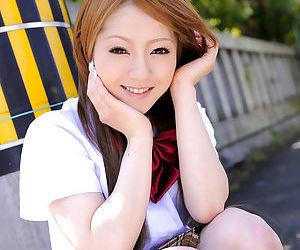 Innocent Japanese schoolgirl Ria Sakurai flashes sexy white panties in public
