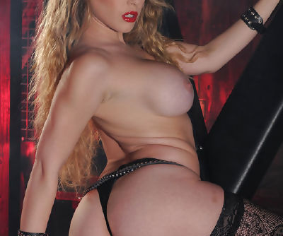 Wild hottie in leather costume is horny and would really love a cock right now