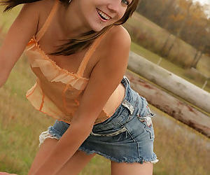 Lovely and seductive broad posing as a cowgirl