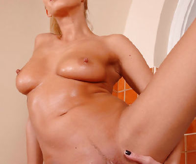 Happy and wonderful chick is fingering her crotch with both hands in the bathroom