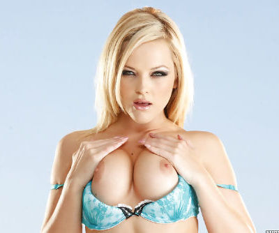 Skinny and charming solo babe Alexis Texas with high heels is demonstrating her butt