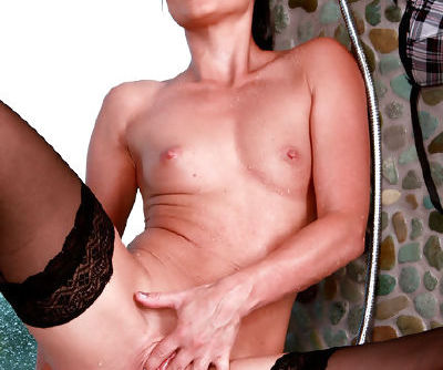 Lovely Monica Sweet likes feeling warm water dripping her nude and sensual body