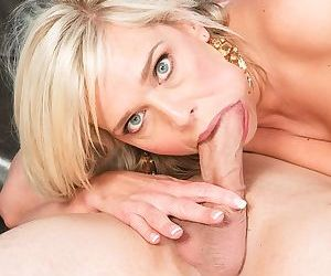 Blonde with fake tits Carey Riley seduces a young stud for some anal slamming