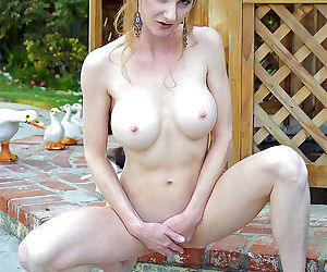 Sensual mature model with big boobs Annie Body undresses outdoors