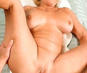 Busty blonde cougar georgette parks gets screwed and facialed by a cute stud - part 571