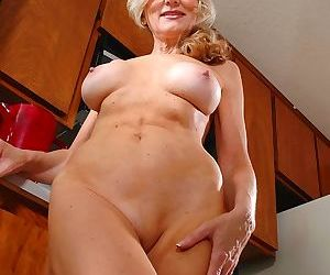 Older busty babe barbara exposes hairy pussy in the kitchen! - part 1917