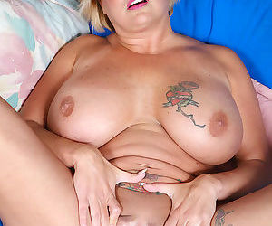 Horny mature blonde with huge tits gets filled by a young studs big cock - part 834
