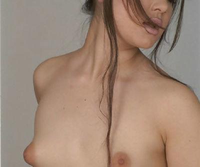Slender brunette with tiny boobies Janine is masturbating her hole