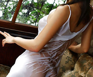 Pretty asian babe Rin Suzuka posing in lingerie and getting wet - part 2