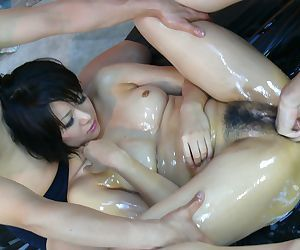 Japanese chick Mito Ayase gets lubed up before being spit roasted
