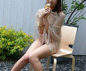 Japanese solo girl Iori Miduki eats an ice cream after fingering her beaver