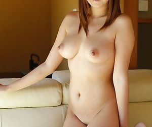 Japanese solo model Nao Mizuki bares her big natural tits in the garden