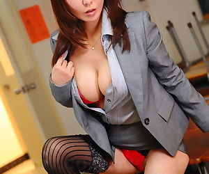 Busty Asian office lady Kyoushi Kan flashes her panties and stockings at work