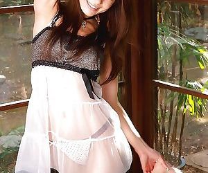 Adorable long-haired asian hottie uncovering her tempting curves