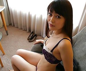 Pretty asian MILF Aoi Katayama undressing and vibing her hairy slit