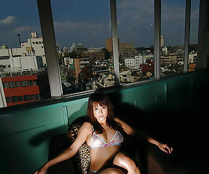 Fuckable asian babe with petite bosoms posing in lingerie and stripping