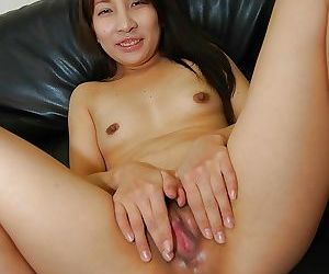 Lusty asian lady Mai Toda getting naked and spreading her pussy lips