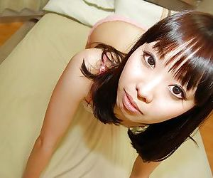 Asian teen Misato Uemoto undressing and exposing her wet hairy cunt