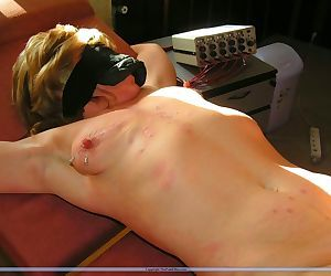 Mature slave gets needles on her nipples - part 2408