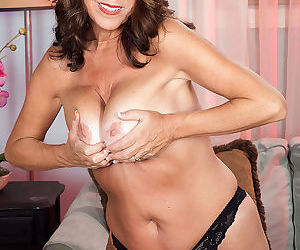 Busty mature woman stripping in black lingerie - part 3112
