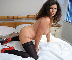 Big breasted mature slut playing on her bed - part 2417