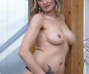 Mature secretary in stockings Ciara flaunts her tits as she dildos her cunt