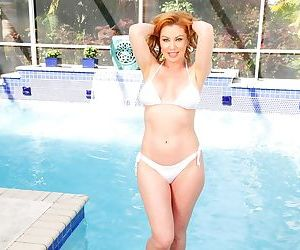 Redhead milf takes off her bikini and masturbating at the pool - part 8