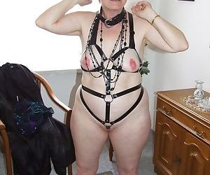 Older BBW with short spiky hair takes off lingerie and fetish gear to go nude