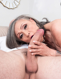 Horny Asian mature granny sucking and riding a young stud cock