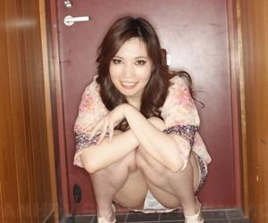 Japanese model Yuko Iijima flashes her lace panties in a short dress