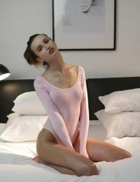 Skinny teen girl Zavya slips off her onesie to show off her hairy pussy