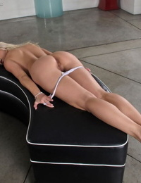 Clothed blonde Anikka Albrite in heels strips white panties to toy pussy