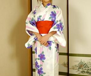 Busty Japanese girl Kasumi sucks and fucks her man wearing a kimono