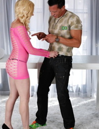 Cute blonde girl Miley May blows and older guy via hole in massage table