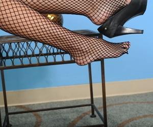 Fishnet stocking clad mature broad Katrina Kink revealing big tits