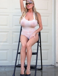 Blonde female Kelly Madison releases her hooters from a wet T-shirt