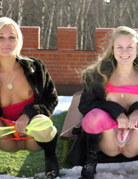 Young lesbians peels off hose and skirts before having fun with sex toys