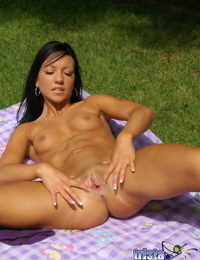 Tanned brunette Trista Stevens spreading pussy naked on a blanket outdoors