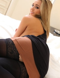 Dirty blonde model Jodie Gasson unleashes her nice tits in black stockings