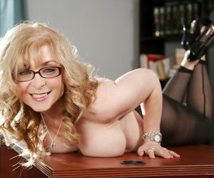 Mature Nina Hartley in glasses fucking young Sara Luvv with strapon in office