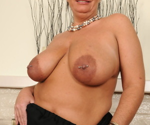 Mature BBW Brooklyn Rain reveals her large boobs as she strips naked