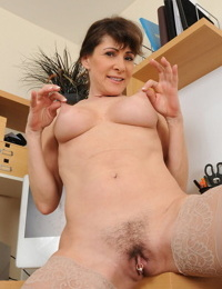 Over-30 lady Alexandra Silk strips naked at her office workstation